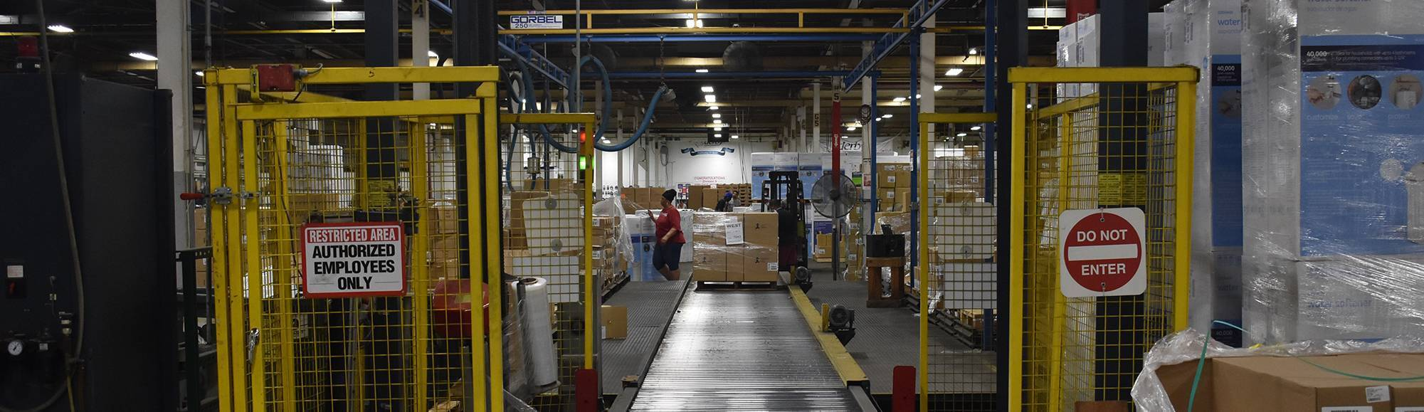 Photo of a view along a conveyor belt at the NIS facility of Derby LLC